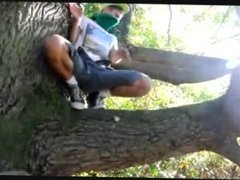 Young Guy Jerking off and Cumming in a tree