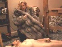Mistress in a luxurious fur coat.