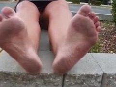 mature shows her dirty feet