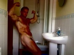 Hot Muscle Hunk with a small cock shows off Naked in a bathroom