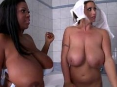 Eva Notty and Maserati washing their massive titties in the bathroom