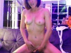 Hot brunette fingers her pussy till orgasm in front of webcam