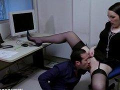 Slutty secretary in stockings rides a cock