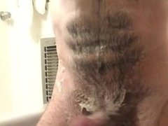 Hairy hunk jerkin all soaped up