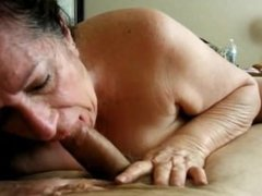Brunette Granny giving oral sex to her lover