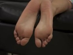 Amateur Asian MILF teases with her bare feet and soaks soles in oil