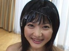 Lovely Japanese babe gets smeared in cum from a gang bang