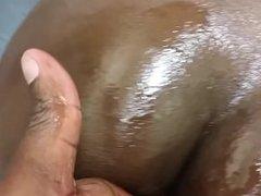 Oiling her big ass
