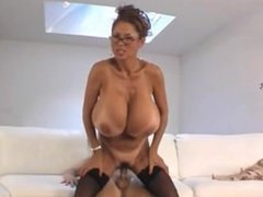 Mom with very big tits amuses her son's friend