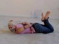 blonde barefoot in jeans tied and tapegagged on the carpet