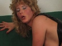 Blonde slut gets her tits sprayed with big load of sperm