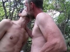 Pig manthroat feeds hungry pupbalto his spit water in public exsposed woods