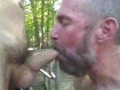 Pig Manthroat gives Pupbalto blowjob in public woods