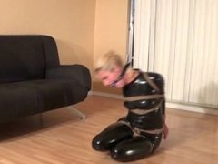 Briella hogtied in a catsuit, part 1
