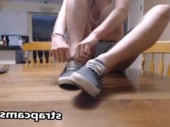 Cute teen stripping in kitchen on table