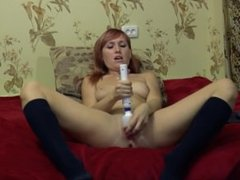 Red-haired girl squirting on the bed HD