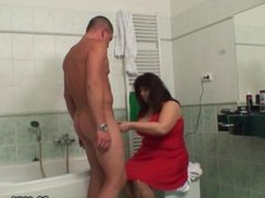 Busty mom in law riding cock in the bathroom
