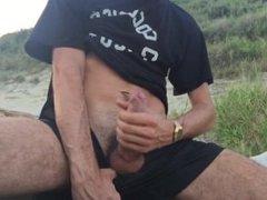 Jerk off on the beach with creamy eruption