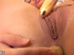 Sweet kitten is gaping spread cunt in close-up and having orgasm