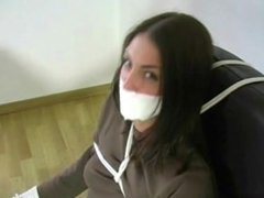 Girl bound and tape gagged to a chair