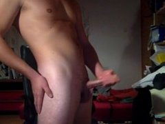 18 years old guy jerking his big and hard cock until he cums a lot.