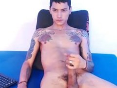 Tatted up latin twink jerks and cums