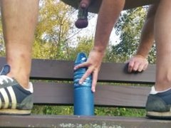 Extreme anal dildo on a park bench