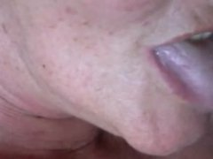 Horny mature sucking a hard shaft - closeup.