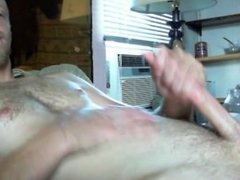 Slim, furry guy jerks and cums