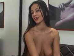 Sexy brunette fingers her pussy in front of webcam