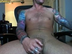 tattoo guy strokes cock on cam