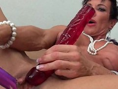 Mature woman toying her huge clit