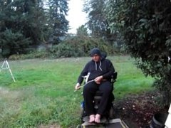 Disabled Guy Takes A Piss In Backyard
