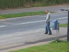 Guy Pisses at the Bus Stop