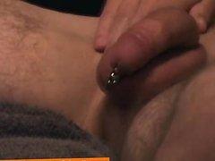 Amateur jock strokes his big pierced cock
