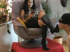 Licking the dirty boots of The Goddess