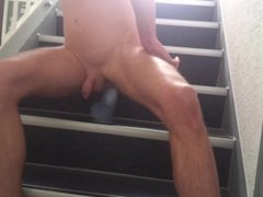 Big dildo ride in the stairways