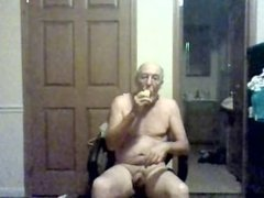 Old man having fun with his dildo