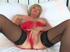 British milf Lulu from AmateurWivesXxx.com works her big naturals and wet p