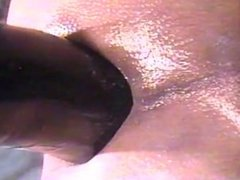 Butt Fucked close up huge black dildo machine.