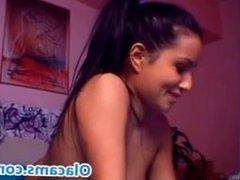 Brunette big-ass sucking dildo on webcam