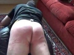 Sexy Mature Mistress Punishing Slave in the Living Room it