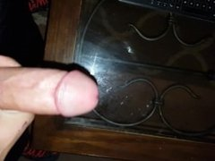 Cumming on the glass coffee table