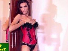 Stripteasing ladyboy pleasuring herself