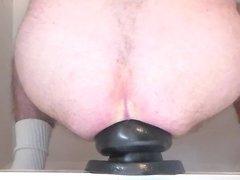 Huge butt plug penetration
