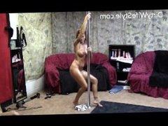 Hot naked brunette pole dancing