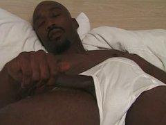 Dark skinned male jerks off