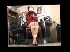 Cute Redhead Secretary tied to a chair at the office