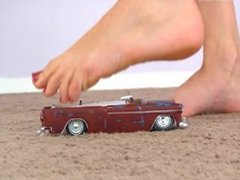 Blonde giantess steps on and crushes a car, and hurts her foot too!