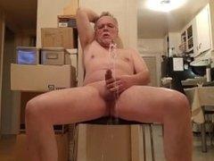 I piss all over myself and masturbate until I cum